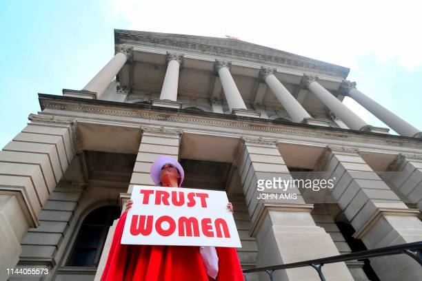 Activist Tamara Stevens with the Handmaids Coalition of Georgia stands outside the Georgia Capitol after Democratic presidential candidate Sen...