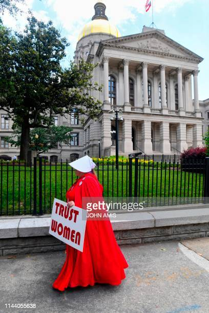 Activist Tamara Stevens with the Handmaids Coalition of Georgia leaves the Georgia Capitol after Democratic presidential candidate Sen Kirsten...