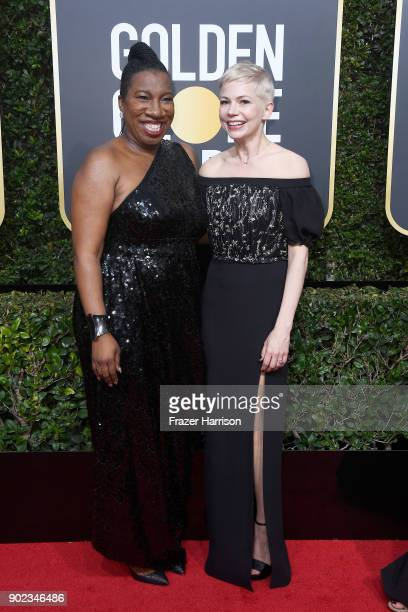 Activist Tarana Burke and Michelle Williams attends The 75th Annual Golden Globe Awards at The Beverly Hilton Hotel on January 7 2018 in Beverly...