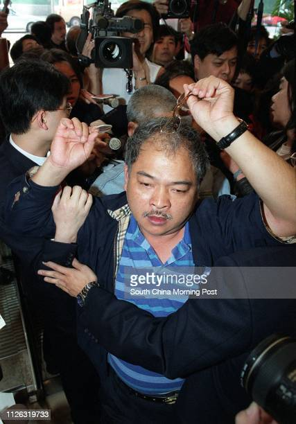 Activist Tsang Kinshing shows his broken spectacles when he was blocked from entering the lift lobby at Harbour Centre in Wan Chai during his way to...