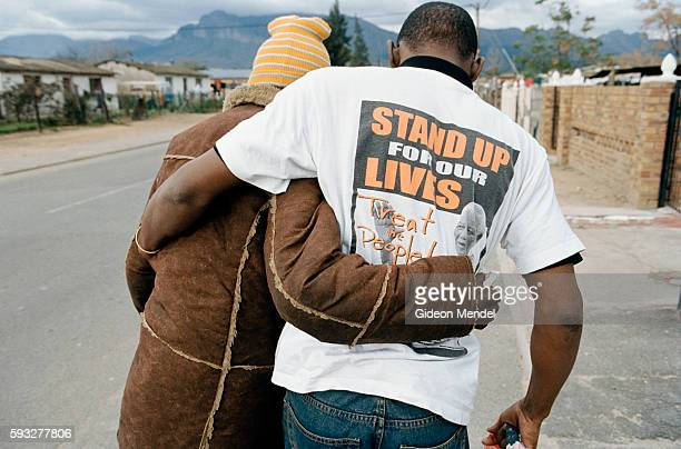 TAC activist Vuyani Jacobs helps 38yearold Christina Mlenze from Mbkweni near Paarl She was the mother of three children and had a CD4 count of 20...