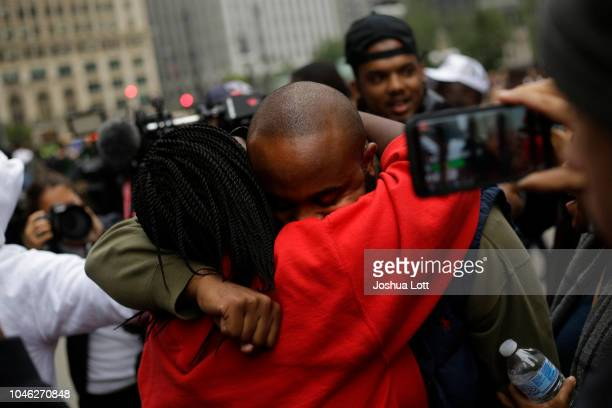Activist William Calloway receives a hug from a protester celebrating the verdict in the murder trial of Chicago police officer Jason Van Dyke along...
