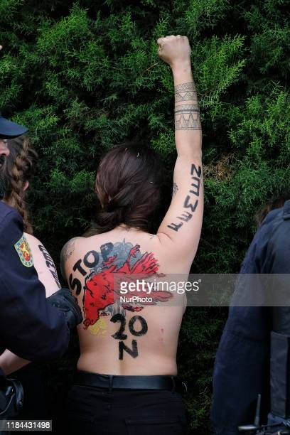 This image contains nudity.) FEMEN activist with body paint reading 'To fascism neither honor nor glory' during a rally commemorating the 44th...