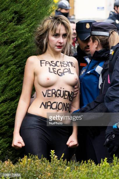 This image contains nudity A FEMEN activist with body painting reading 'Fascism is legal National shame' protests during a rally commemorating the...