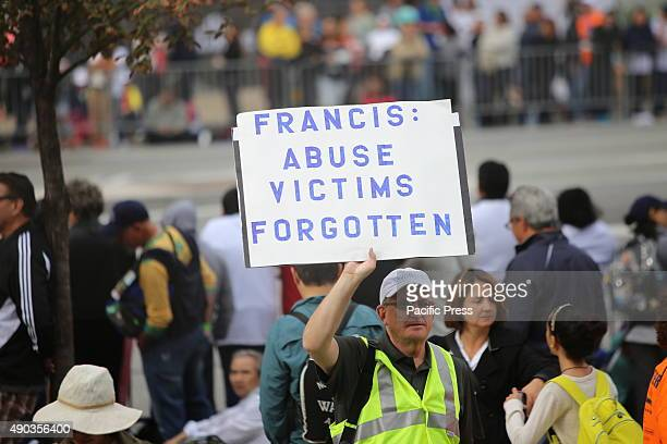 Activist with sign denouncing the church's alleged lack of response to the abuse of children by clergy Pope Francis arrived at the Cathedral Basilica...