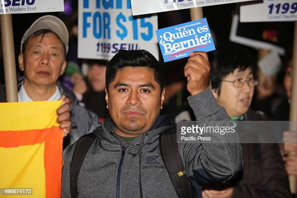 Activist with Spanish language Bernie Sanders sign Fight for Fifteen's national day of action began with a walkout of fast food employees and a rally...