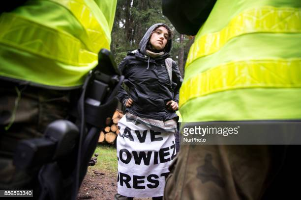 Activist woman during interrogation by Border Guard unit after blockade of Harvester Bialowieski forest on September 22 2017