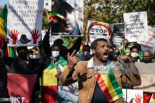 Activist Yohannes speaks during a demonstration to bring attention to ethnic cleansing and genocide against the Amhara ethnic group in Ethiopia on...
