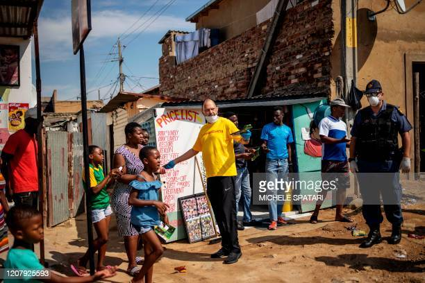 Activist Yusuf Abramjee distributes soap bars amid concerns over the spread of COVID-19 coronavirus during a volunteer drive in the densely populated...