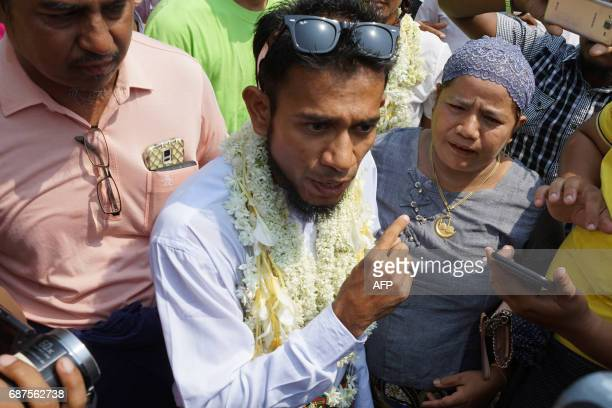 Activist Zaw Zaw Latt greets friends and family members after being released from Oo Bo prison in Mandalay on May 24 2017 Myanmar granted amnesty to...