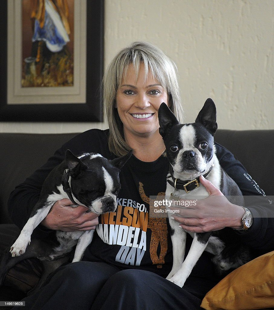 Activist Zelda le Grange appears with her dogs Winston and Indire during an interview on July 25, 2012 in Johannesburg, South Africa. Zelda and some of South Africa's popular personalities just returned from the third Biker 4 Mandela tour, which aims to raise money and help various charities countrywide.