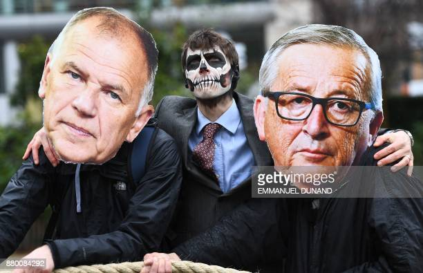 TOPSHOT Activists acting as European Commission President JeanClaude Juncker EU Commissioner in charge of Health and Food safety Vytenis Andriukaitis...