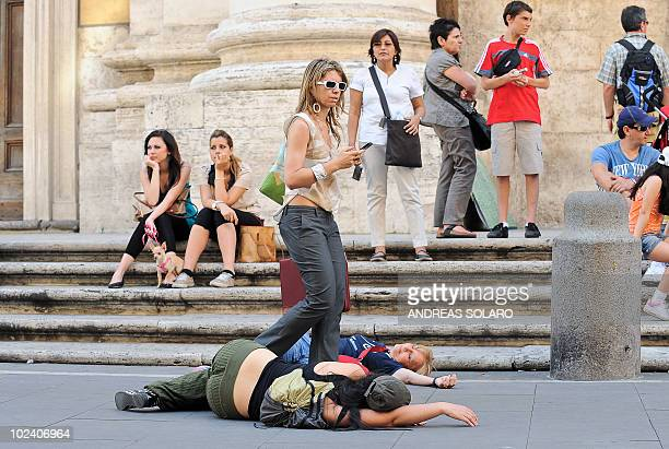 "Activists against nuclear energy take part in a ""flash mob"" as they protest against the Italian policy on nuclear, in Rome on June 25, 2010. A flash..."