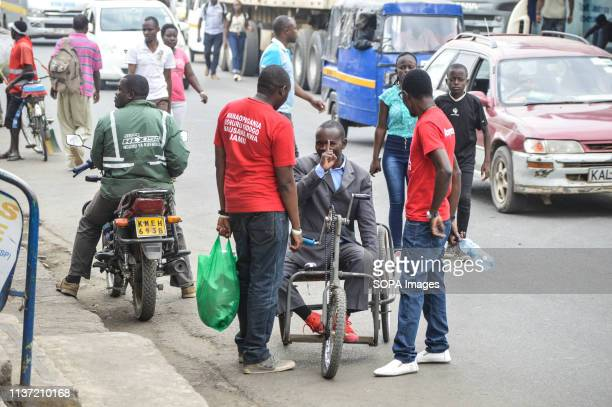 Activists allied to Kenyas Red Vests Movement are seen engaging a member of the public in the streets of Nakuru during the anticorruption protest...