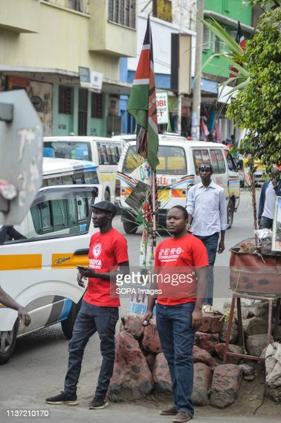 Activists allied to Kenyas Red Vests Movement are seen walking on the street of Nakuru during the anticorruption protest Activists allied to Kenyas...