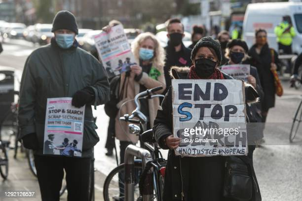 Activists and community groups block the A10 road outside of Tottenham Police Station in protest at the targeting of black youth by officers and...