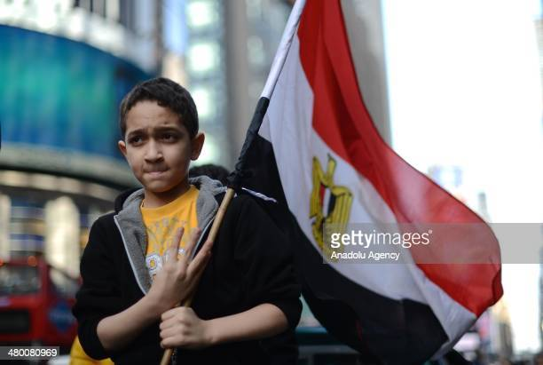 Activists and Egyptians living in New York City gather at the Times Square on March 22 2014 during a demonstration against Egyptian army chief...