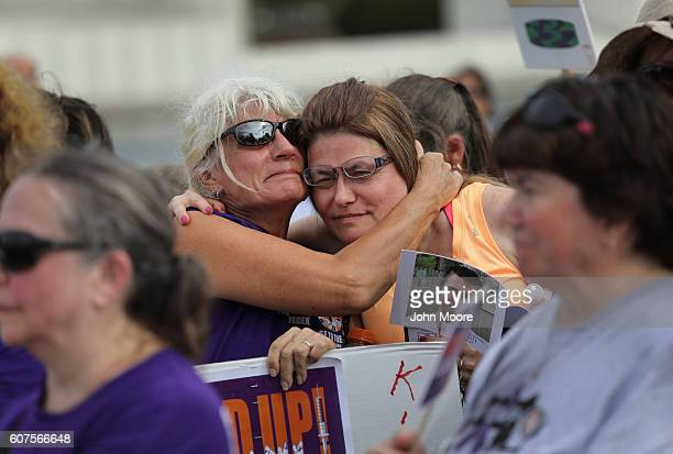 Activists and family members of loved ones who died in the opioid/heroin epidemic take part in a 'Fed Up' rally at Capitol Hill on September 18 2016...