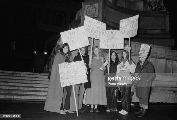 Activists and members of the 'Women's Liberation Movement' protest against the Miss World Beauty Pageant outside the Royal Albert Hall where the...