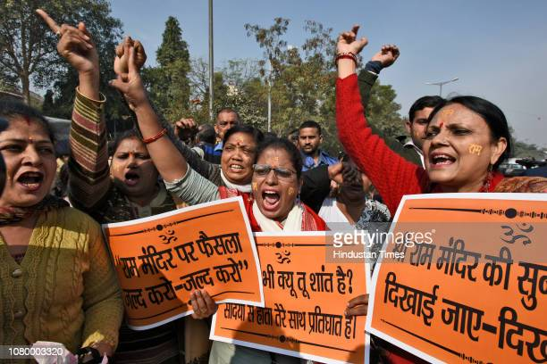 Activists and members of various Hindu groups shout slogans during a protest to demand the construction of the Ram Temple, near the Supreme Court on...