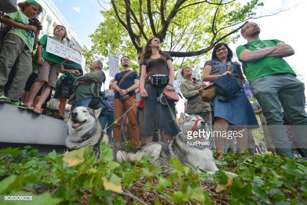 Activists and protesters from 'Love Primeval Forest of Bialowieza' during a protest in front of ICE Congress Center where the 2017 World Heritage...