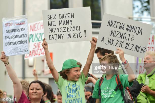 Activists and protesters of all ages from 'Love Primeval Forest of Bialowieza' during a protest in front of ICE Congress Center where the 2017 World...