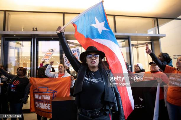 Activists and Puerto Rican community members block the entrance to MOMA as they protest against Steven Tananbaum a board member of the Museum of...