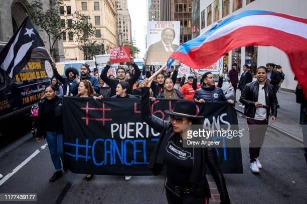 Activists and Puerto Rican community members protest against Steven Tananbaum, a board member of the Museum of Modern Art , for his involvement in a...