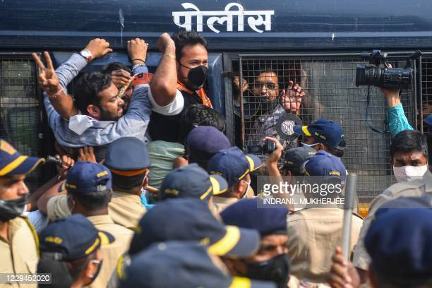 Activists and supporters of Bharatiya Janata Party shout slogans as they are detained by the police while protesting against the arrest of Indian...