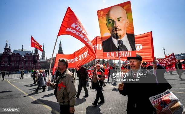 TOPSHOT Activists and supporters of Russia's leftwing parties and movements march during a May Day rally in downtown Moscow on May 1 2018