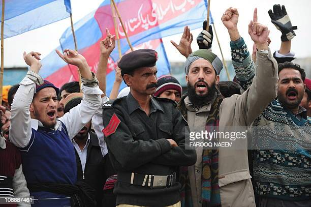 Activists and supporters of Shabab-e-Islami Pakistan and Sunni Muslims shout slogans outside the Adiyala prison in Rawalpindi on February 1 in the...