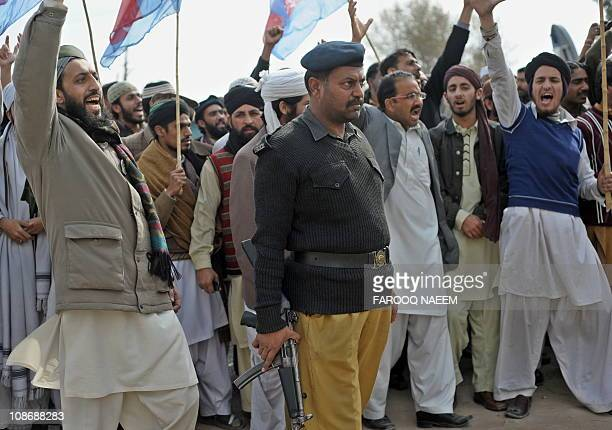 Activists and supporters of Shabab-e-Islami Pakistan and Sunni Muslims shout slogans outside the Adiyala prison in Rawalpindi on February 1 in...