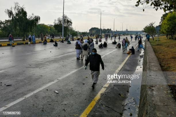 Activists and supporters of Tehreek-e-Labbaik Pakistan , a religious party, block the Islamabad-Rawalpindi highway during an anti-France...