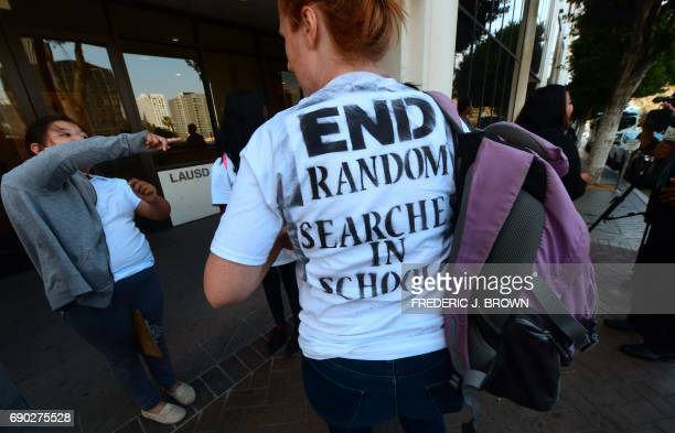Activists and supporters of the #StudentsNotSuspects coalition gather outside the Los Angeles Unified School District headquarters before a rally on...