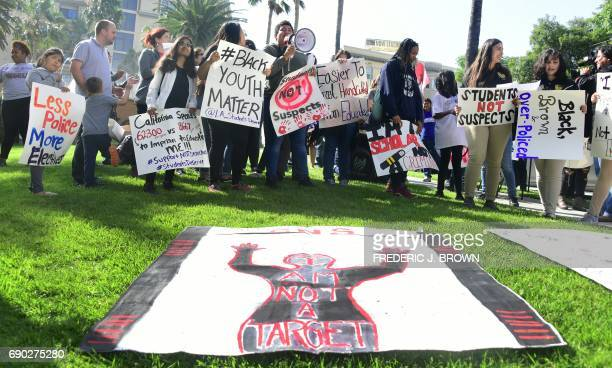Activists and supporters of the #StudentsNotSuspects coalition rally outside the Los Angeles Unified School District headquarters on May 30 2017 in...