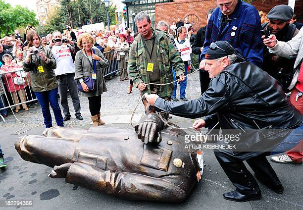 Activists and sympathizers of Hungarian 'Szolidaritas' Movement prepare to transport the broken down plastic statue of Hungarian Prime Minister...
