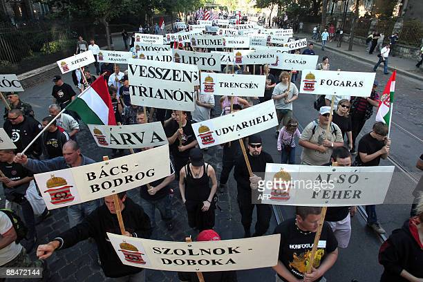 Activists and sympathizers of the nacionalist 64 Counties Youth Movement hold some counties' name of former Hungary as they march together to the...