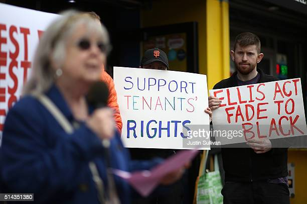 Activists and tenants of 1049 Market Street hold signs as they stage a protest against the landlord's attempts to evict them from the building on...