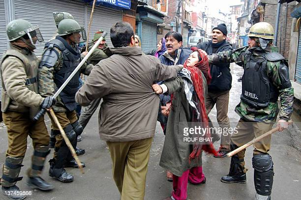 Activists and their female relatives of Hilal War political party scuffle with Indian police during a protest in Srinagar on January 21 2012 People's...
