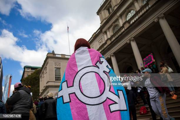 Activists and their supporters rally in support of transgender people on the steps of New York City Hall, October 24, 2018 in New York City. The...
