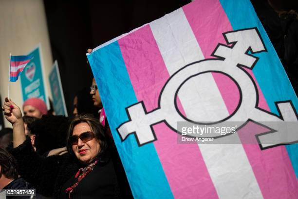 T activists and their supporters rally in support of transgender people on the steps of New York City Hall October 24 2018 in New York City The group...