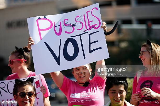 Activists and volunteers from Planned Parenthood rally against Republican presidential candidate Donald Trump across the street from the Trump...