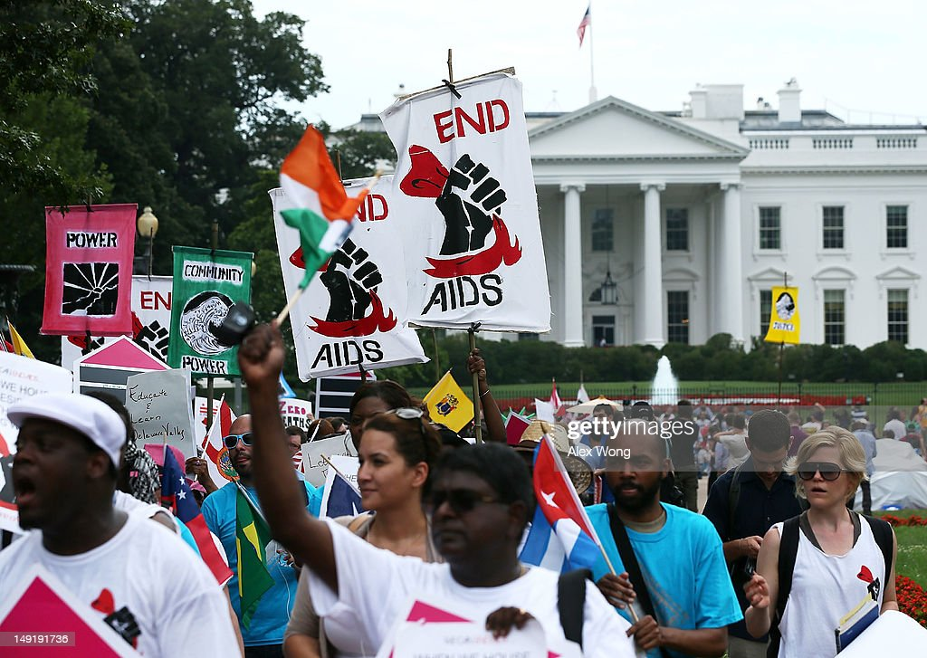 Activists arrive at Lafayette Square, north of the White House, after a march from the Washington Convention Center July 24, 2012 in Washington, DC. AIDS activists from organizations all around the world participated in the march to 'demand rights and resources to confront and cure HIV/AIDS.'