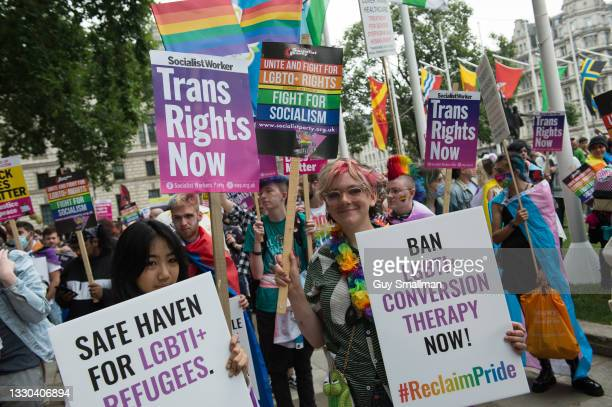 Activists assemble in Parliament square as thousands attend the Reclaim Pride march on July 24, 2021 in London, England.