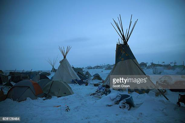 Activists at Oceti Sakowin near the Standing Rock Sioux Reservation brace for sub-zero temperatures expected overnight on December 6, 2016 outside...