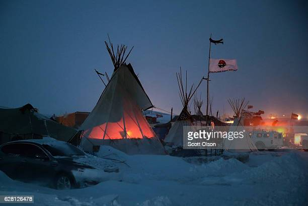 Activists at Oceti Sakowin near the Standing Rock Sioux Reservation brace for subzero temperatures expected overnight on December 6 2016 outside...