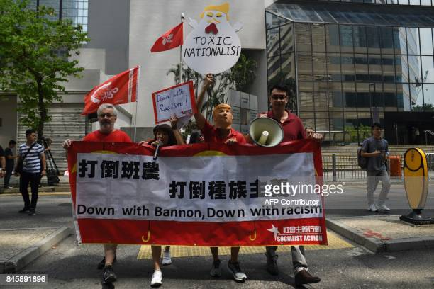 Activists attend a protest against US President Donald Trump and the visit of former White House strategist Steve Bannon ahead of his expected speech...
