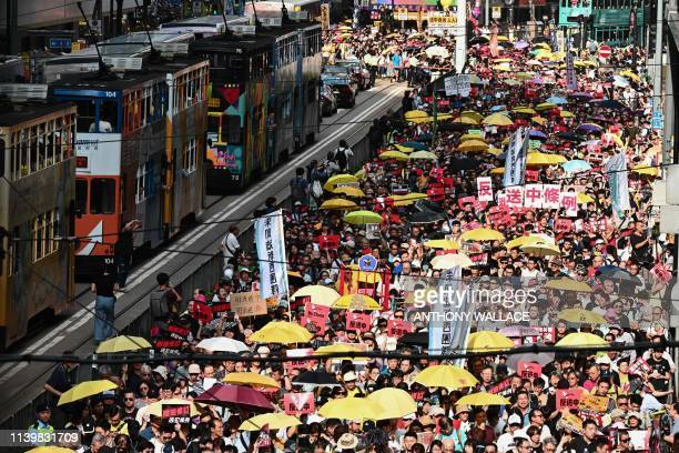 Activists attend a protest in Hong Kong on April 28 against a controversial move by the government to allow extraditions to the Chinese mainland. -...