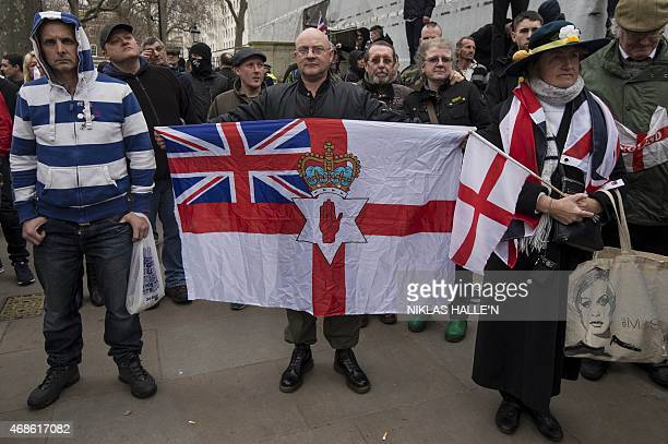 Activists attend a rally by the British offshoot of the Germanybased PEGIDA movement on Whitehall in central London on April 4 2015 PEGIDA stands for...