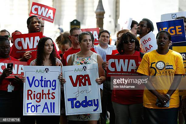 Activists attend a Voting Rights Amendment Act rally in Capitol Hill June 25 2014 in Washington DC The rally marked the oneyear anniversary of the...